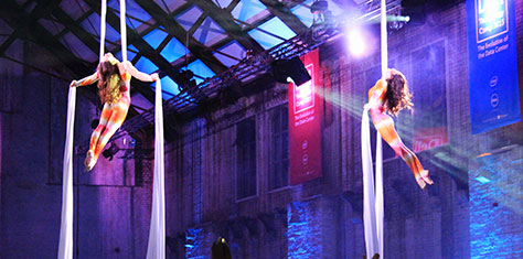 Acrobatics performing aerial acts with silks